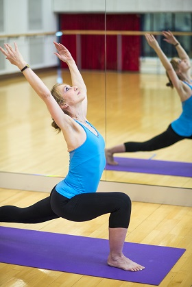 woman performing pilates move
