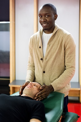 man giving reiki massage