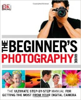 Book cover of 'The Beginner's Photography Guide, The Ultimate Step-By-Step Manual For Getting the Most From Your Digital Camera'.