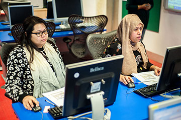 two women students working on computers