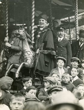 Rev Lax in Mayoral Robes on Carousel c 1918