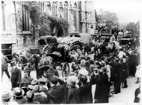 Crooks' funeral procession passing St Stephen's Church, East India Dock Road